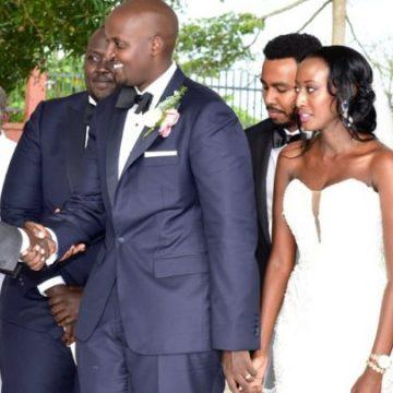 President Museveni shakes hands with Isaac Kutesa via mikolo.com